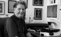Dr. Richard Schlegel in his office (black/white photo)